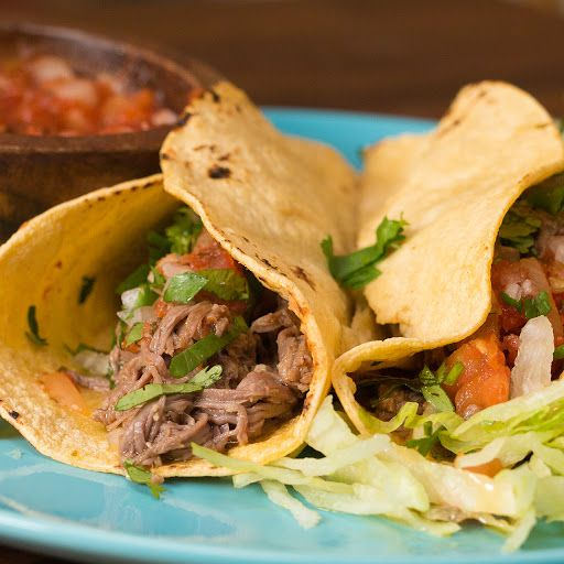 Slow Cooker Shredded Steak Tacos With Flank Steak, Chili Powder, Garlic Powder, Cumin, Salt, Pepper, Olive Oil, Garlic, Lime, White Vinegar, Chicken Broth, White Onion, Cilantro, Salsa, Corn Tortillas