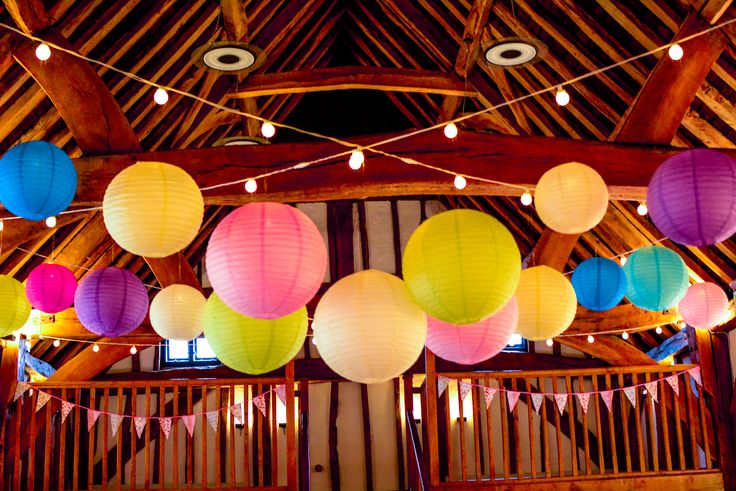 Beautiful lanterns showing their unqiue colours with warm white festoon lights and buttonlites The Tudor Barn, Burnham