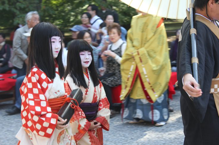 Shelby Barbe: It has the traditional clothes and traditional outlook of the Japanese people. In this photo you can see two young participants of the Jidai Matsuri(時代祭)while they were marching in the parade. This festival is very famous in Kyoto (京都)and is one of the top three biggest in Japan. This festival is also known as the Festival of the ages as it has a lot to do with the history of Japan. It was held in the Imperial Palace grounds, Kyoto.