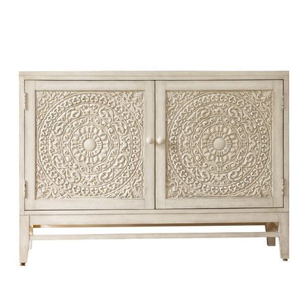 Stylist's Tip: Washed in white, this poplar wood chest boasts a versatile look—but its ornately medallion door make it a seriously a stand-out piece. Let it be the focal point of a crisp and classic dining room, or place it in the entryway to impress guests and set a stylish tone for your home.