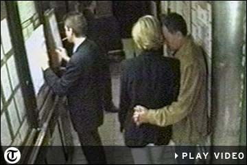 Princess Diana and Dodi Fayed share a tender moment as they patiently wait for the car inside the Ritz Hotel in Paris which was to take them on their final journey.