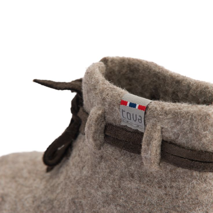 TOVA JORVIK WOOL SLIPPER. For your little Viking!  Based on a medieval Viking shoe. 100% natural-colored Merino wool with a hand-stitched suede sole. A Viking shoe made of goatskin was found during excavations in medieval Jorvik (modern-day York, England).  TOVA has re-created this shoe in cozy wool to make a Viking slipper. Comes in a cotton bag with Viking print. Norwegian Design. tova.no . birchcountrystore.com
