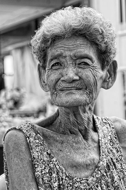 Each wrinkle has a story...Bangkok, Thailand. Old lady, woman, female, aged, wrinckles, powerful face, hurt? emotional, expression, lines of Life, beauty, portrait, photo b/w.