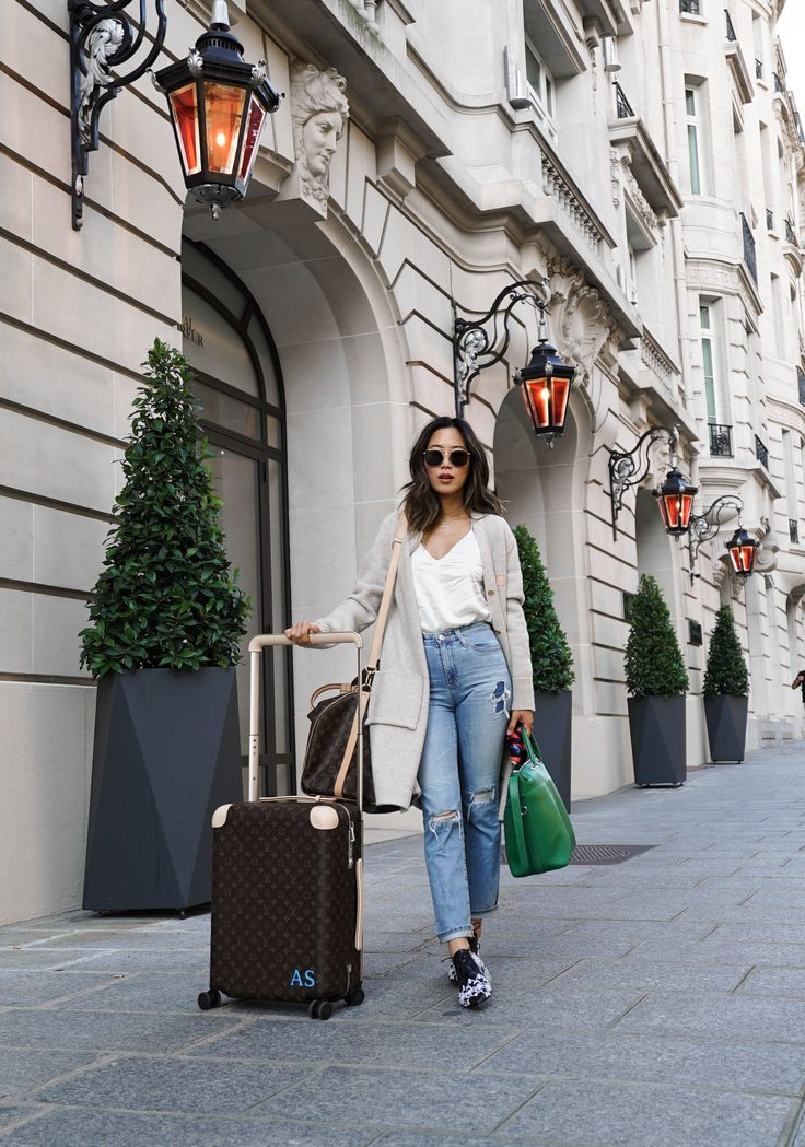 Aimee Song of the blog Song of Style shares her tips for achieving easy but chic airport style for those long travel days.