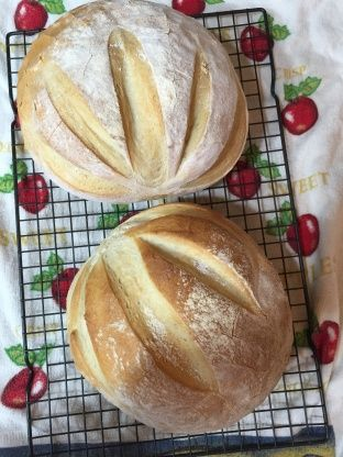 This recipe came with my Kitchen Aid mixer, and makes two absolutely beautiful loaves of French Bread. I misplaced my recipe book and recently found it again, so am adding this recipe to Zaar for safe-keeping! Make sure you use a very, very sharp knife to make the diagonal slashes. This bread is delicious on its own, for sopping up stew or soup broth, and with your favorite cheeses or toppings. Prep time specified includes rising time.