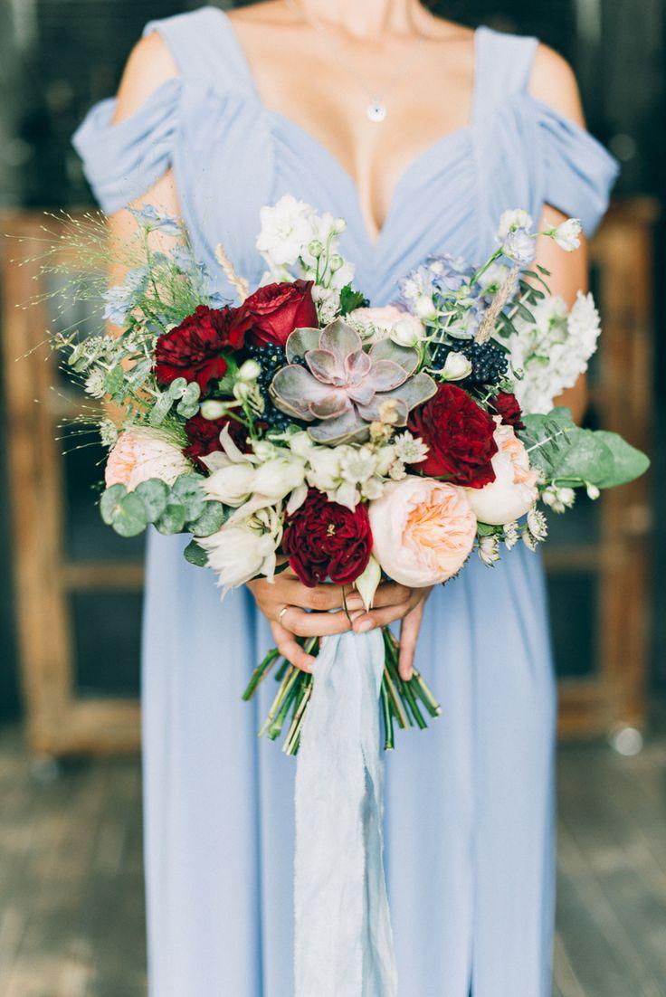 Bridal bouquet of David Austin roses, delphinium, carnation, serruria, eucalyptus, viburnum, astrantia, echeveria