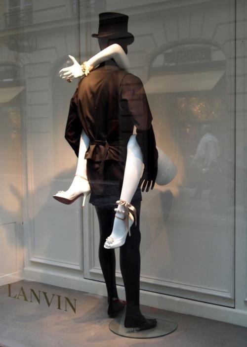 "Lanvin WIndow Display - what a creative way to display shoes and a bracelet. The ""female"" is just and arm and 2 legs - no body! We have mannequin limbs for sale at MannequinMadness.com"