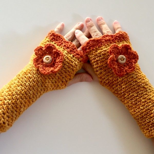 Fingerless gloves crochet pattern with flower. Fingerless gloves allow you to use your digital devices while keeping your hands toasty warm. Crochet Pattern - Shannon's Fingerless Gloves with Button Flower - Little Monkeys Designs