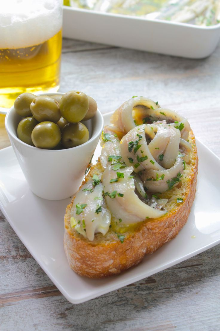 Boquerones (white anchovies)- delightful Spanish tapas traditionally served with beer