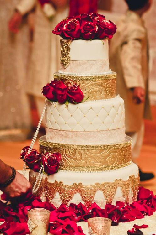 Gold, cream, red roses Indian wedding cake | Wedding Style inspiration by Marigold Paper