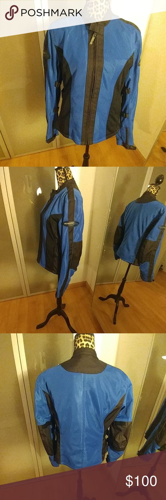 Black and royal blue jacket Are utility jacket use for skiing.. has pockets on the inside and outside and velcro under the arm and on the side to adjust.. in good condition I pointed out a little defect on top.. Schott NYC Jackets & Coats Utility Jackets