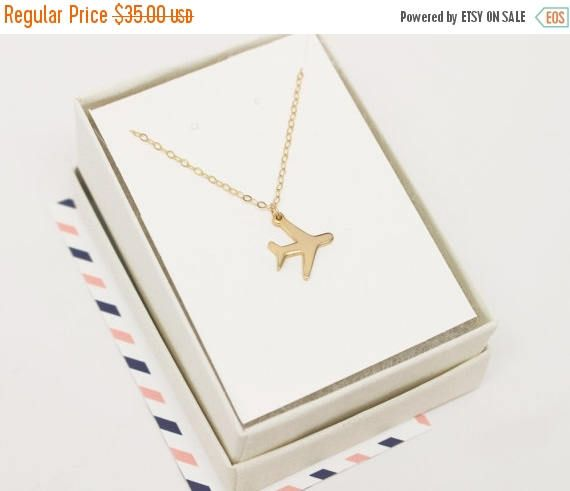 Our adorable airplane charm now comes as a beautiful pendant necklace! It is simply and delicately designed to show off your love of travel and wanderlust nature.  LENGTH: - Airplane charm is approx. 1/2 by 1/2 inch - Choose your custom necklace length. Refer to necklace chart  MATERIALS:  - Gold airplane charm is gold plated over stainless steel and tarnish resistant - Airplane charm is the same on both sides - Chain and findings are gold filled - Springring clasp - Comes in beauti...