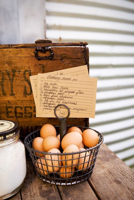 Vintage Wooden Eggs Box and a Basket of Eggs to Make Blackberry Crumb Pie