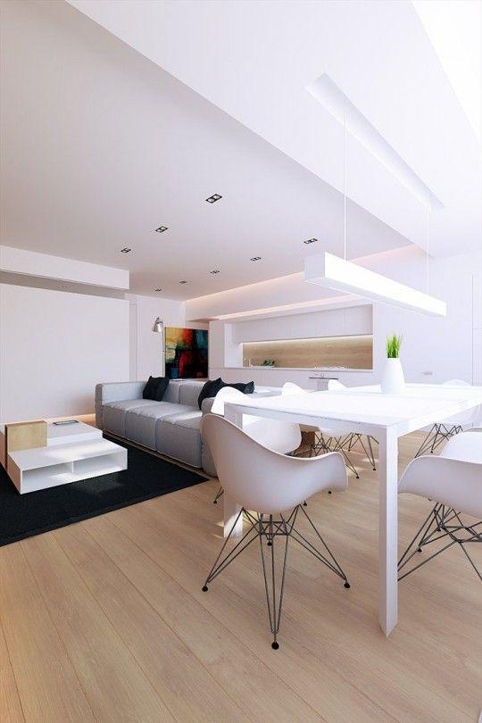 Salle à manger design blanche dans intérieur contemporain