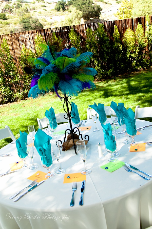 Peacock feather centerpiece photo by kenny backer for Teal wedding theme ideas