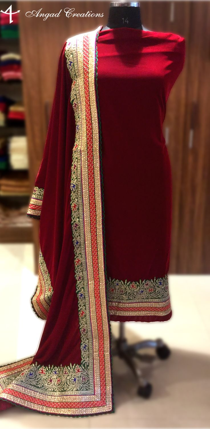 "Enhance your Style with this Beautifully Crafted Royal Velvet Suit and get ready for any Occasion. Details Velvet Shirt with embroidery on Ghera and with embroidered velvet Dupatta. Fabric of Bottom: Crepe Semi-Stitched Length is 48"" Ghera is 28"" Color of base is Maroon."