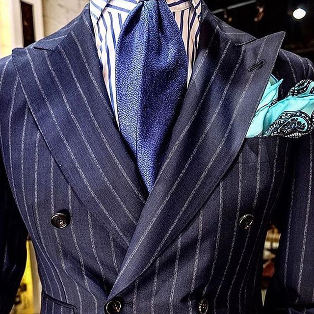Sexy. Look at it. It looks elegant yet masculine. Bold without being flamboyant and striking without being overly aggressive. This suit suggests that you're a man to be reckoned with, a man of global means and one who consorts with two or three perfect examples of olive skinned voluptuousness at once on a king sized bed in a suite on a yacht gliding across the sun kissed water of some exotic location. This suit says you're a man of mystery yet also a man who women suspect is equinely…