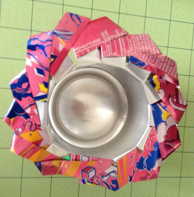 Recycle brisk raspberry iced tea can flower weaving holder.