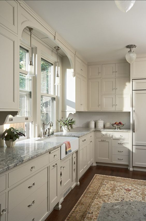 White Kitchen Cabinets, Gray Granite Countertops, Dark Wood Floors, Persian Rug -- Kitchen Cabinet Paint Color Benjamin Moore OC- 14 Natural Cream