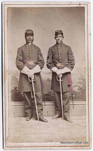 Union Army Soldiers, 1865  Full length double portrait, two African American Union Army soldiers with swords, standing [hand tinted]. Randol...