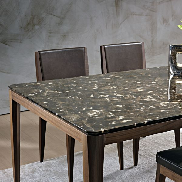 Designed by Matteo Nunziati for Pacini e Cappellini, the marble Cut dining table is a classic design, executed in superior materials with exceptional detailing.