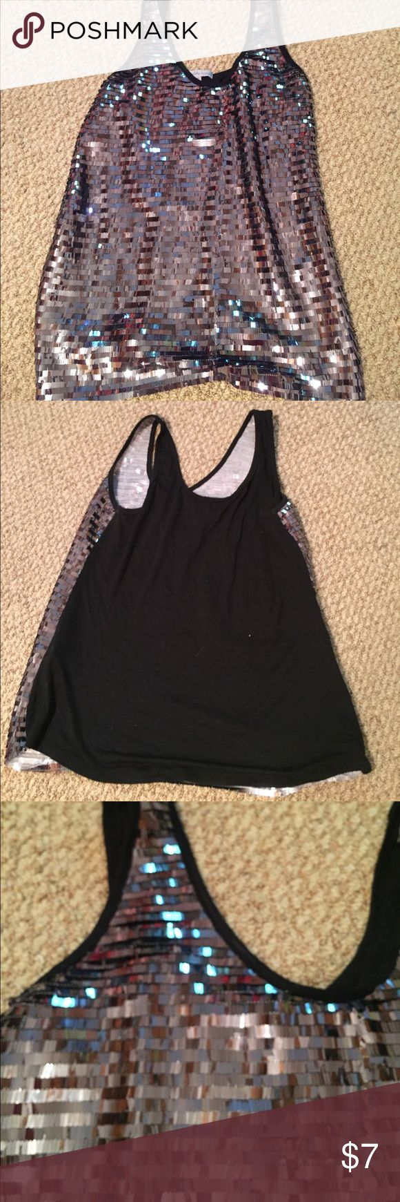 Sparkly tank top This tank top is perfect for a fun night out! It has a sequenced front with a solid black back. One inch straps. Charlotte Russe Tops Tank Tops