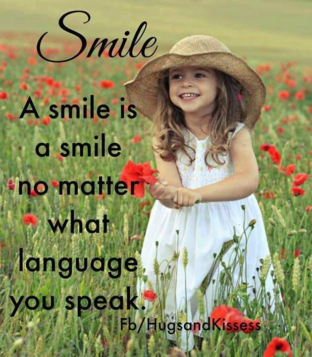 Smile. A smile is a smile no matter what language you speak.