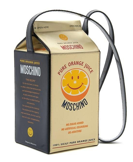 Description: A Moschino 'Orange Juice Carton' Bag,   with a long blue leather shoulder strap. Stamped: Moschino.   8 x 4 inches