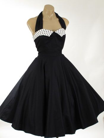 1950's.  My aunt had a dress so much like this one!  Big black flat button ear-bobs with clear rhinestones and bangle bracelet to match!!!