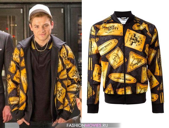 Kingsman: Секретная служба: на Эггси (Тэрон Эджертон) куртка 'Plaque' от Adidas Originals от дизайнера Джереми Скотта