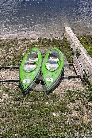 Kayaks on the shores of Lake  in Rożnów , Poland. Europe.  Waiting for tourists…