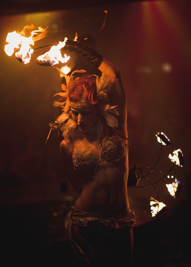 Fire Dancer.  Looks great, but materials in her costume are just asking to catch fire.