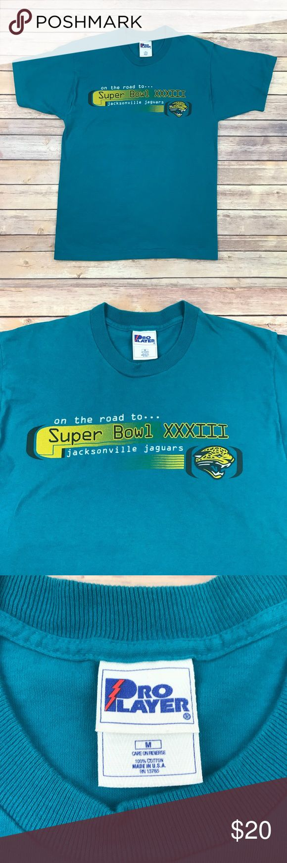 "Vintage Jacksonville Jaguars Graphic Tee Vintage Jacksonville Jaguars Graphic Tee ""On the road to Super Bowl XXXIII"" 1998 Season Schedule Size Medium 100% Cotton Made in USA  Measurements laying flat: underarm to underarm- 19.5"" center back length- 27.5"" M2 Proplayer Shirts Tees - Short Sleeve"