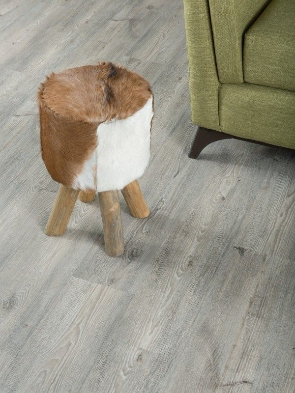 How cute is this faux fur stool against this lovely vinyl flooring (but looks like wood ) Such natural elements but at a fraction of the cost. So chic!