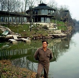 """Johnny Cash at his """"nature house"""" on Old Hickory Lake near Hendersonville. Cash was having a few beers with architect Braxton Dixon at the site,..."""