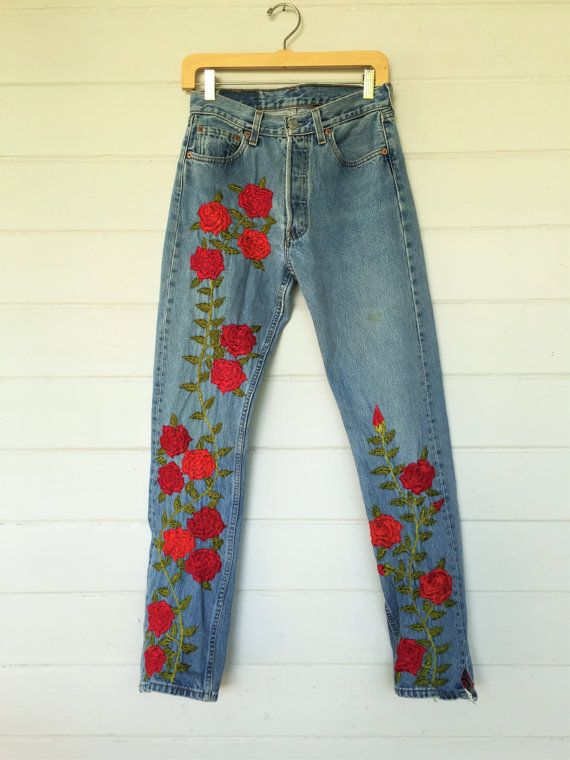 vintage Levis 501s. unreal rose embroidery front and back. high waist slim fit. worn and soft. button fly fabric: denim condition: