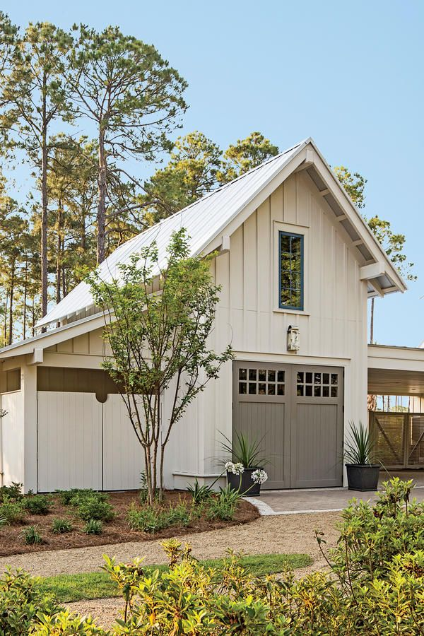 Exterior: The Garage - Palmetto Bluff Idea House Photo Tour - Southernliving. Intended to double as an entertaining space, this structure has a steep two-story profile to up the building's drama and balance the main house. In lieu of hardware, Ken notched the doors to make handles.