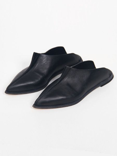 Wal & Pai black leather slip-on mules with modern falcon detail