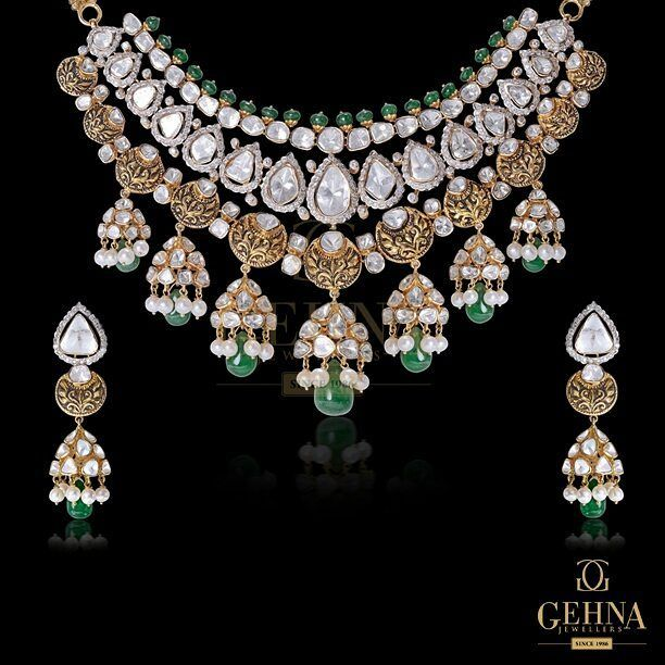 An impressive necklace holding dome-shaped tassels of #polkis and green #gems will mesmerize onlookers with its vintage charm! #GehnaForJewellery