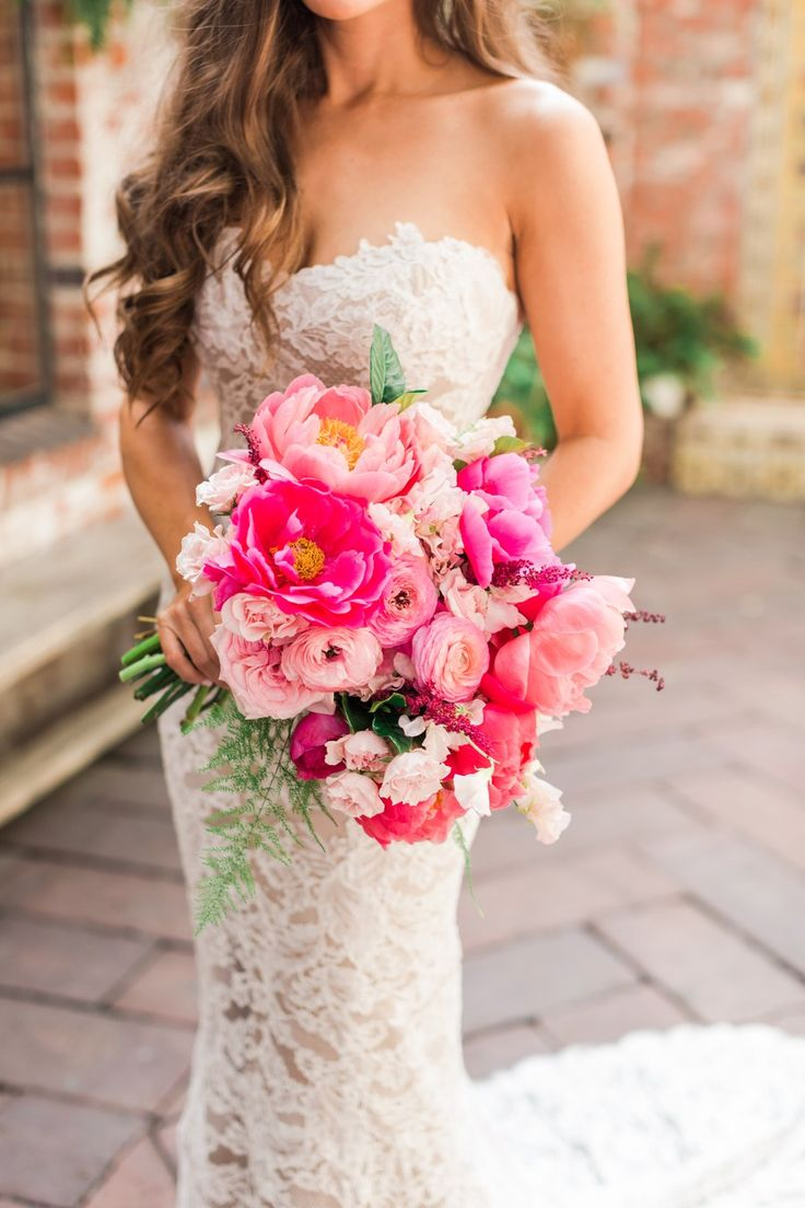 Take a cue from this chic California bride and ask for a mix of blooms in different shades within the same color family. The Little Branch used ranunculus, peonies, garden roses, astilbe, pink majolica, sweet pea, and plumosa to craft this pretty-in-pink bouquet.