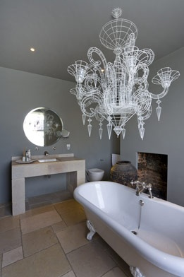 wowsers... love the circle mirror and sink