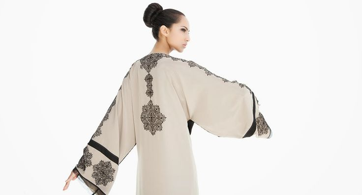 The first two abayas pictured {above and directly below} are my favourites from the Arabesque website of the Spring 2014 collection. Very ...