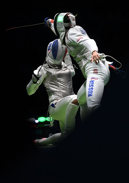#RIO2016 Russia's Aida Shanaeva competes against France's Ysaora Thibus during their women's individual foil quarterfinal bout as part of the fencing event of...