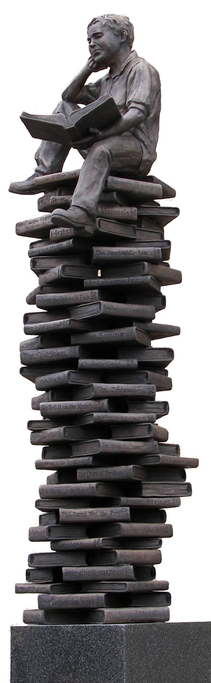 The Centennial Statue at the Coshocton Public Library is the creation of sculptor Alan Cottrill of Zanesville, OH.  The sculpture features a young boy holding an open book and sitting atop a stack of 100 books. Each book represents one year of the Library's service to the community.