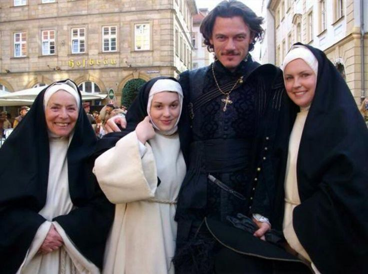 Luke Evans with Nuns... Okay you may continue pinning.