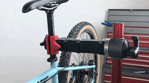 The only stand that uses a push-button clamp instead of a manual crank. Genius!