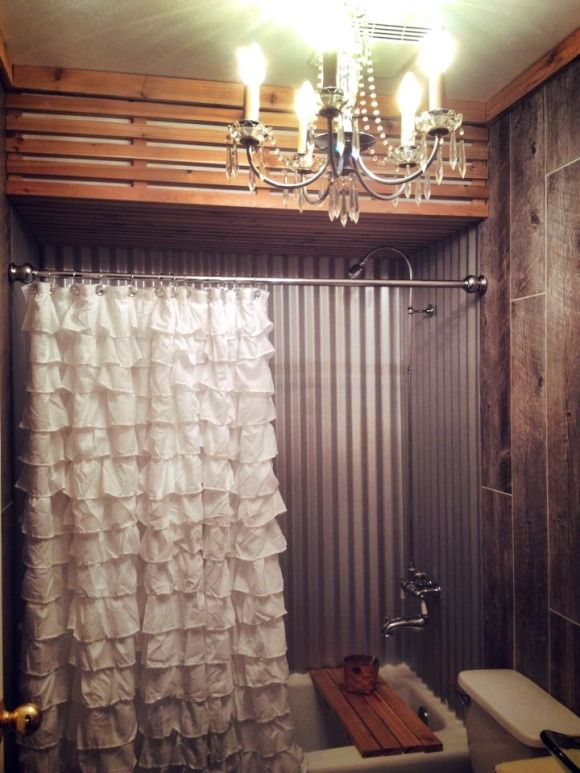 I LOVE the corrugated sheet metal on walls of tub. Fancy Rustic Elegant all in one Bathroom
