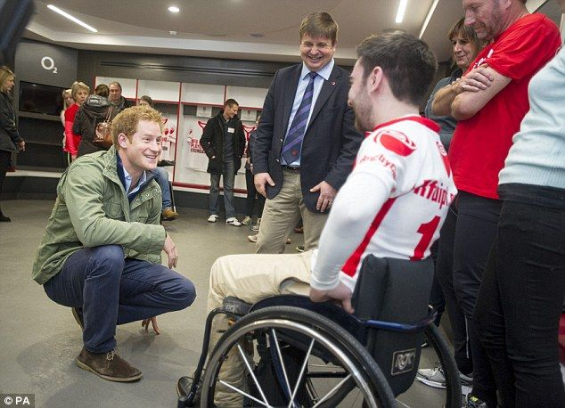 Prince Harry, patron of the Rugby Football Union Injured Players Foundation (IPF),talks to PF director Dr Mike England (centre) and Dr Liam O'Reilly IPF fundraising officer (right) at Twickenham Stadium