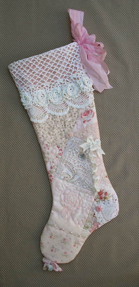A peachy pink patchwork Christmas stocking.