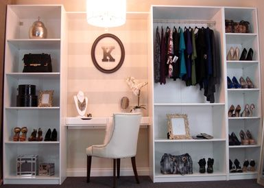 Who knew a few stock bookshelves, creative wall paint, and pretty styling could create such an elegant closet vanity?